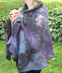 These summer shawls are perfect for chilly summer evenings or overcast days. Made of merino wool with lettuce edged hems they are embellished with hand dyed silk.